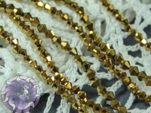 Бусины Биконусы нить 2мм металлик золото