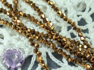 Бусины Биконусы нить 2мм металлик темное золото