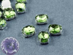 Кристалл в серебряной оправе Овал 10x8мм Peridot
