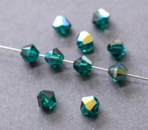 Хрустальные бусины Swarovski биконус 5328, 4мм Emerald AB